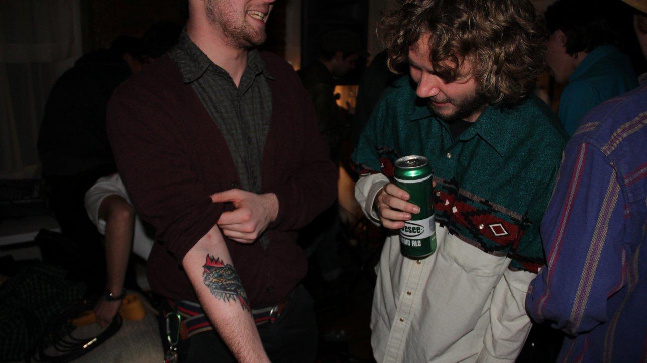 Alex Van Horn showing off his new iguana tattoo.