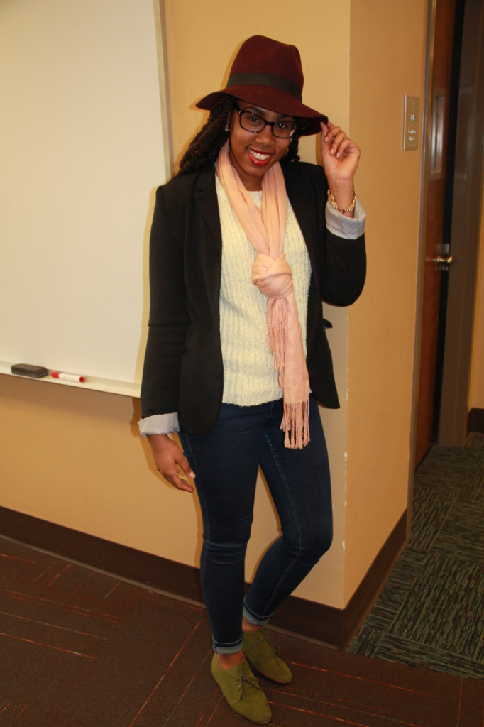 Angela Ward, Social Work Major.  Wearing a hat from Cotton On, scarf and jeans from Charlotte Russe, and a thrifted sweater and blazer.