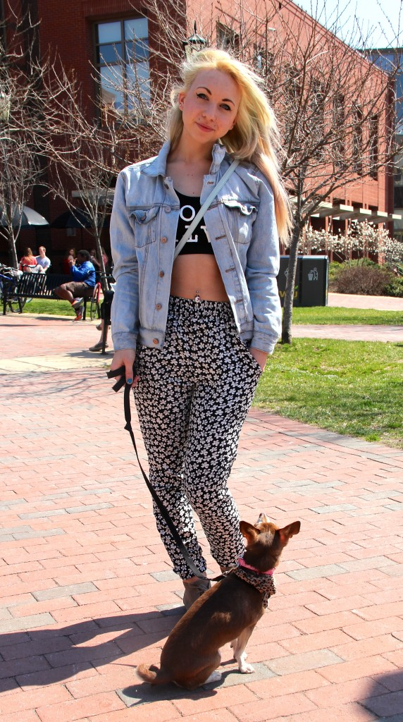 Samantha Henri, Sociology major, with her dog Rapunzel.  Wearing pants from Pac Sun and a top from Forever 21.