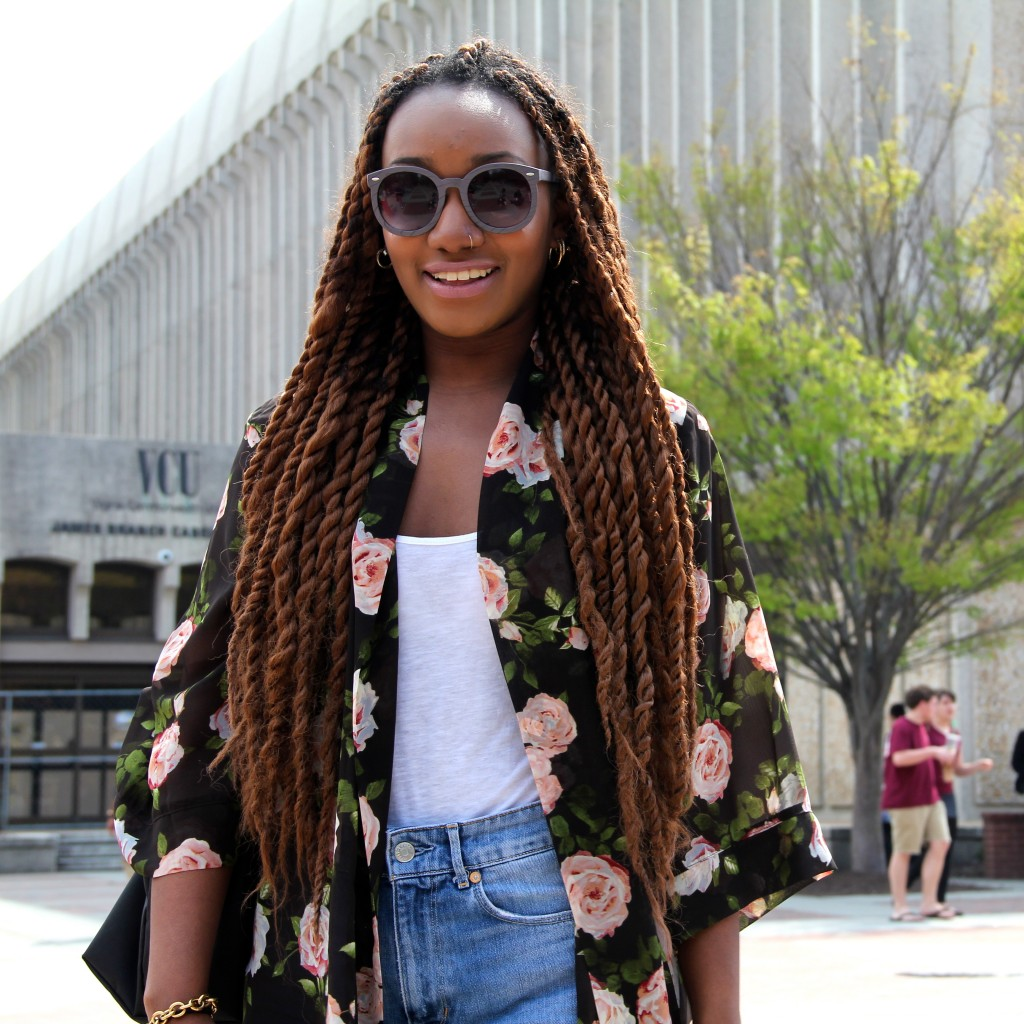 Nia Haynes, History major, wearing a Forever 21 Kimono and sunglasses from Rumors Thrift boutique.