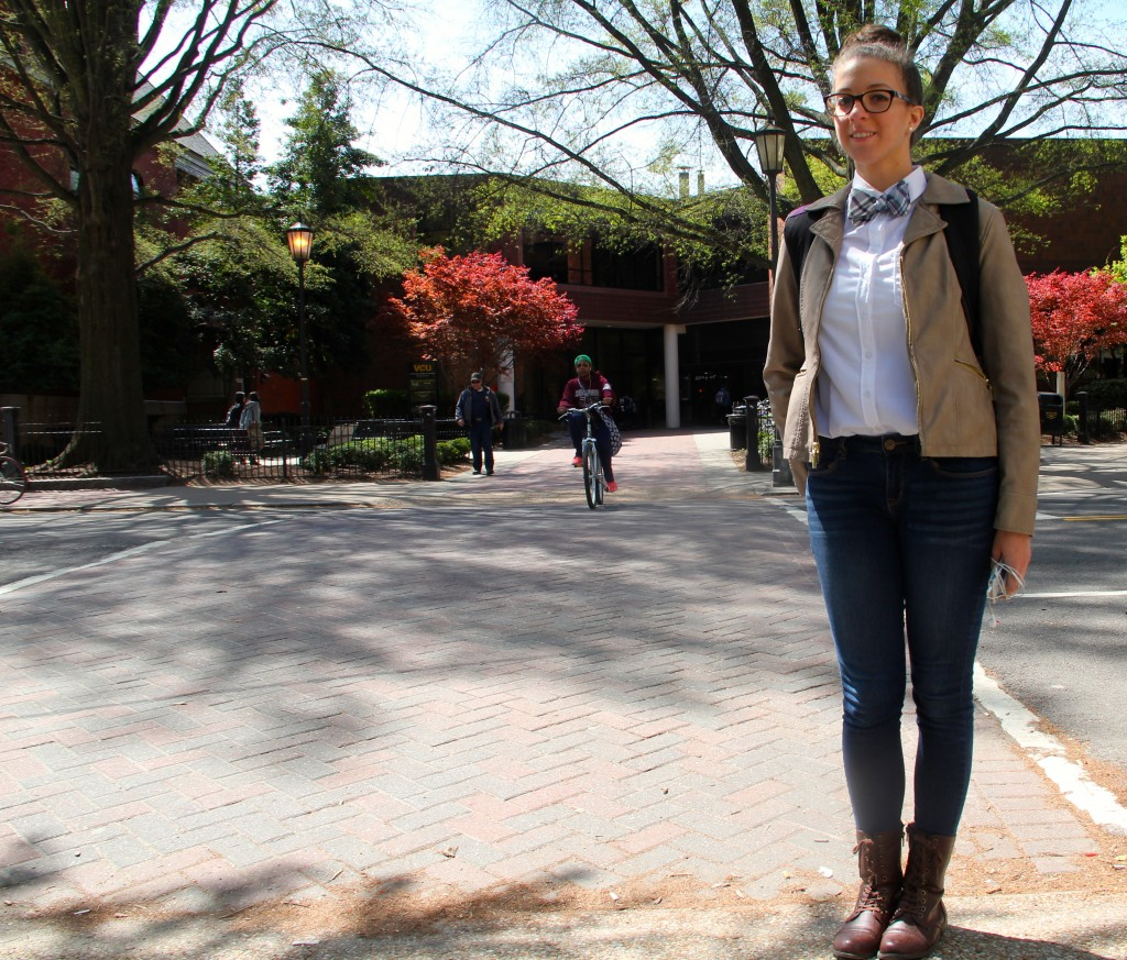 Elizabeth Urena, Communication Arts major, wearing a shirt and jeans from H&M, bow tie from a friend, and gifted boots.