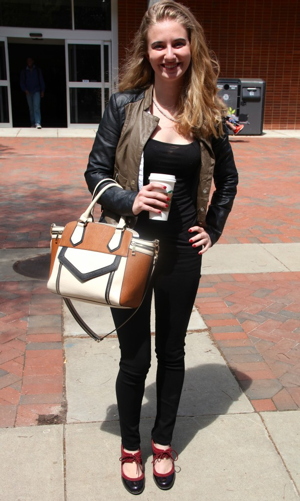 Emily McGee, Fashion Merchandising major, wearing a bag by Aldo.